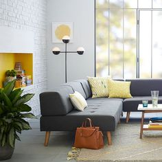 SATURDAY IS BRIGHT IDEAS. This modern, sculptural floor lamp was created in collaboration with Kate Spade Saturday. Reminiscent of New York City subway entrance lamps, it adds a unique look beside a sofa or by the bedside.