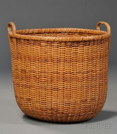 """Round Nantucket Basket, made by A.D. Williams, Nantucket, ac. 1910-40, deep round form with carved hardwood handles and turned base, the base inscribed """"Light Ship Basket/Made by A.D. Williams/Nantucket, Mass.,"""" (minor loss), ht. 11 3/4, dia. 12 1/2 in."""