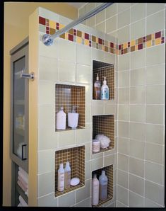 Creative tile patterns and rich paint shades turn a blah bath into a much brighter space.