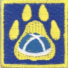 'Scouting Traditions' badge for Finnish Brownie/ Cub Scouts. The blue hat (VÄISKI) is traditionally worn by Finnish Girl and Boy Scouts when they are abroad.
