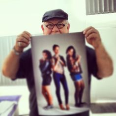 ©Nadi Bay Photography. Peter Henning of Three Loose Coconuts in the office checking out some prints.