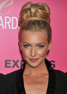 Detailed top knots as worn by Melrose Place star Katie Cassidy are dramatic and flattering. Christian Lacroix used them on many of his runway models.