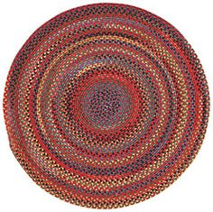 The round Songbird Rug in Cardinal would be perfect in any open space. #CapelRugs #MadeInAmerica