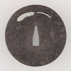 Sword Guard (Tsuba) Date: late 14th century Culture: Japanese Medium: Iron, copper