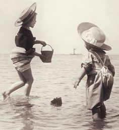 +~+~ Antique Photograph ~+~+   Children in bloomers playing in the ocean with their sand pails.