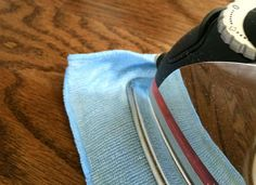 Fix annoying dents in your wood with this trick that uses an iron and a damp rag. So easy!