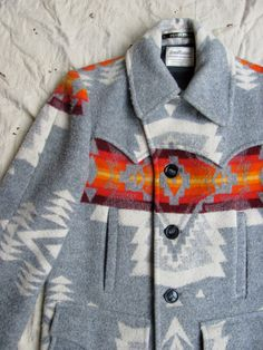 This Pendleton coat reminds me so much of the one my grandfather wore around the Rez, up in the great North woods.