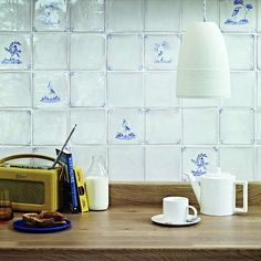 Why we are all falling for the dainty delights of Delft tiles - Traditional backdrop: Delicate Delft tiles like these by Fired Earth are a crisp addition to this k - Delft Tiles, Tiles, Dutch Kitchen, Wall And Floor Tiles, Kitchen Wall Tiles, Kitchen Wall, Fired Earth, Blue Kitchen Tiles, Delft
