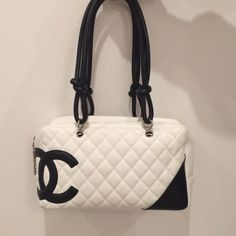 AUTHENTIC CHANEL Ligne Cambon Bowler shoulder bag! AUTHENTIC White quilted bowler bag with black CC logo. Worn once. Has tags and authenticity card! Can't miss this amazing bag! Will negotiate. CHANEL Bags Shoulder Bags