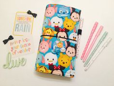 My new line of cute and fun Kids Sunshine Doris! Disneys Tsum Tsum!!  **POCKET NOT INCLUDED! MAY BE PURCHASED SEPARATELY**  A pretty travelers notebook / fabric faux dori that perfectly compliments your child's imagination and fun! A creative traveling book for drawing, doodling, or as a super fun sticker book!! A mechanical pencil and stickers will be included with each Kids Sunshine Dori. **Color of the mechanical pencil and stickers will vary**  Each of my Kids Sunshine Doris are strong…