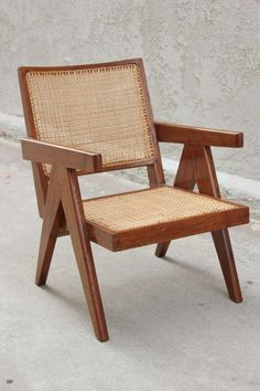 1stdibs.com   Pair of Pierre Jeanneret Lounge Chairs
