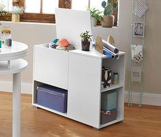 349,95 zł Tchibo, szafka-pojemnik z pokrywą i przegródkami do przechowywania przedmiotów np. na czasopisma albo segregatory.