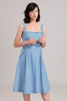 <p>Go for a fifties look with this classic stripy sundress. The design features wide gathered shoulder straps, a sweetheart neckline and an A-line skirt with feature pockets. Fitted at the waistband with flat pleats on the hips and back skirt to create a