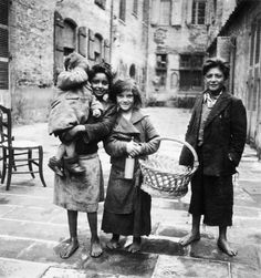 Four Gypsy children pose for a photograph [probably in the town of Rivesaltes