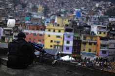 Snipers observe the Rocinha slum during the inauguration of its Peacekeeping Unit Program (PUP) in Rio de Janeiro, Brazil, September 20th, 2012.  Reuters photo/Ricardo Moraes