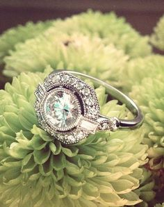 In this vintage-inspired engagement ring, a bezel-set center diamond floats above a halo of diamond accents bordered by an octagonal frame. Bezel-set baguette accents create a look of shimmering beauty (average total carat weight). Vintage Rings, Vintage Jewelry, Unique Vintage, Vintage Art, Vintage Clothing, Vintage Style, The Bling Ring, Brilliant Earth, Dream Ring