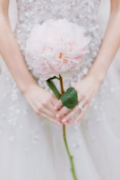 Bride - one long stem and also one in hair (Peony / David Austin Rose or the like). Can we make a few for the hair so we can replace as they wilt?