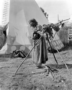 A First Nations woman smoking meat - c.1910, Western Canada [Photo by Harry Pollard]