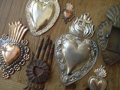 Hammered tin pendants.