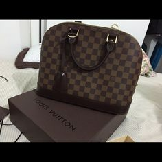Louis Vuitton Alma PM Damier Ebene Canvas Only used twice. I have everything including the receipts, lock, and key. Will pm to interested buyers. May be willing to trade. Thank you. :) ON HOLD FOR ALMA TRADE Louis Vuitton Bags