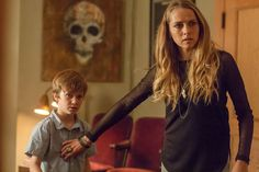 Movie Still from Lights Out featuring Teresa Palmer and Gabriel Bateman
