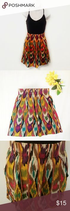 "CAbi Printed Skirt Perfect condition with no stains, tears, or signs of wear. Elastic waistband measures 13"" while laying flat. Length is 18"". Two hidden front side pockets. 100% rayon. Machine washable. CAbi Skirts"