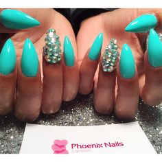 Aqua stiletto nails with bling fing