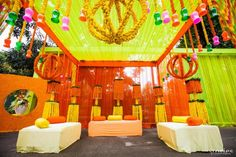 One of the best things about mela is the colourful and fun filled ambience. So, how about if you incorporate the mela theme in your mehendi ceremony? Indian Wedding Theme, Indian Wedding Planning, Indian Wedding Decorations, Desi Wedding, Backdrop Decorations, Diwali Decorations, Flower Decorations, Mehndi Decor, Mehendi