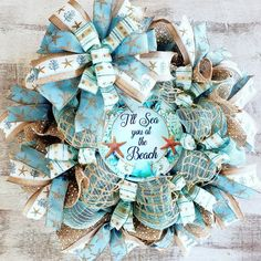I'll see You at the Beach Wreath. This is perfect for any wall, door, entry porch area. Welcome your guests this season it will look amazing all through the year and years to come. Coastal Wreath, Nautical Wreath, Seashell Wreath, Seashell Crafts, Beach Wreaths, Coastal Decor, Lighted Wreaths, Deco Mesh Wreaths, Ribbon Wreaths