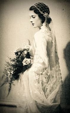 "Bride with an air of Shakespearean romance, thanks to that ""Juliet Cap"" stlye veil, 1930s."