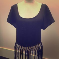Fringe crop top Never worn, black fringe top! Perfect for any spring/summer occasion! Can be dressed up or dressed down! Charlotte Russe Tops Crop Tops