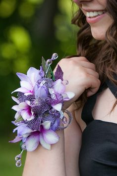 Custom purple corsage with lavender two-tone orchids for a black Prom or Homecoming dress | flowers by Viviano Flower Shop | photo by Arising Images
