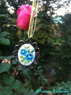 Follow me on instagram : kanavicelerim       #kanaviçe #kanaviçekolye #crossstitch #handmade Butterfly Cross Stitch, Cross Stitch Flowers, Diy Embroidery, Cross Stitch Embroidery, Minis, Palestinian Embroidery, Cross Stitching, Wind Chimes, Pendants