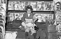 """Girl reading comic book in newsstand"" by Teenie Harris (c. 1940-1945) © 2006 Carnegie Museum of Art, Pittsburgh"