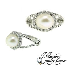 Pearl ring with diamond halo.