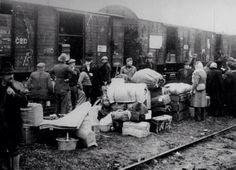 Soviet Russians deporting Latvians to Siberia. June 14, 1941 Thousands of people (whole families, women, children and old people) were taken from their homes, loaded in freight trains &  sent to death camps in to Siberia.