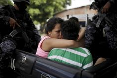A woman kisses a suspected gang member as he is arrested during an anti-gang search operation in San Salvador, El Salvador June 21, 2015. The Salvadoran Police and Army participated in a search operation in response of a deadly attack where two soldiers were killed by gang members on Sunday, local media reported. REUTERS/Jose Cabezas