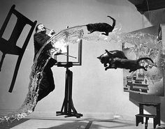 Salvador Dali painting with flying cats.