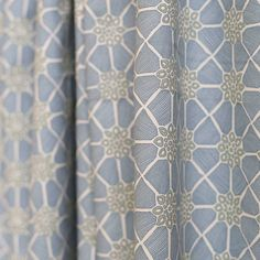 A block print fabric in powdered stone blue with weathered green printed on a natural, unbleached cotton.Suitable for curtains,…