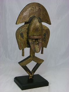 """A Superb African Tribal Art, Kota Reliquary Janus    Material: Wood, Metal, Brass, Copper  Dimension: 27""""H x 7"""" x 4""""  Overall Condition Good, scrapes and cracks please look carefully at the pictures which may also reveal condition and damage.  Mid 20th Century  We can provide more pictures, just let us know.  Base comes with the piece.  FREE SHIPPING WORLWIDE !    The reliquaries were kept outside the homes, in huts at the edge of the village. Only the initiates of the lineage had access to…"""