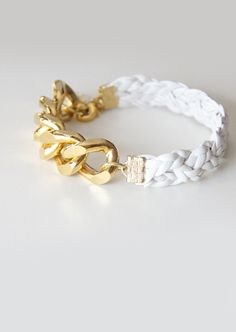 "Our extra chunky white bracelet is made of white craft synthetic leather and a chunky chain finished in 24k gold plated chunky chain. Size 6.5"" - 8"" (comes with an adjustable clasp). The bracelet can be made to any measures. #armcandy #jewellery #accessories"