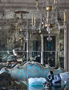 "turquoise damask sofa looks brilliant against ""antiqued"" mirror panels."