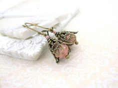 Noe Victorian gold-speckled dusty pink earrings. Czech glass rosebud beads are nestled within antiqued brass filigree flower petals and dangle from long, dainty ear wires.