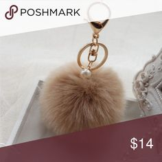 Faux Rabbit Fur Pom Pom with Pearl Furry Faux Rabbit Pom Pom Ball Handbag Charm Light Coffee in Color  Fluffy and lovely (simply use a hair dryer to fluff them up)  A perfect gift for your family and friends   Materials: Fur, Faux Pearl  Ball diameter: 3.15inch(approx)  use on purses, mk, coach, Luis vutton, Michael kors, gucci, betsy, chanel, hobo, cross body, tote, fossil, satchel, backpack, bag, inspired, LV, bucket,tory burch, Kate spade, phone case, keychain Cinderella's Closet…