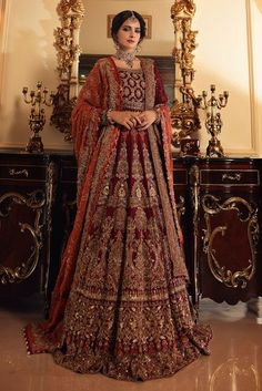 Maroon raw silk lehnga with heavily embellished front and back. Paired with an embellished chiffon shirt, a heavily embellished dupatta with pallu work will complete the perfect bridal look.