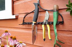Repurposed Rake:  When an old rake falls apart, turn it into functional and rustic décor. Tie a piece of rope around the head, then hang it upside down on a nail or wall hook. Store hand tools, like trowels and shears, between the teeth.