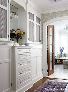 Julianne Stirling; beautiful built-in's! For the wide hall, across from the laundry room