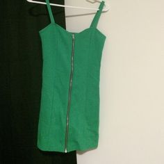 Stretchy Christmas dress! Green, H & M , super stretchy mini dress with zipper. Worn once. Has a small snag on the front and a small grey mark on the upper back (in photos). Fits like a small or extra small. No trades thanks! H&M Dresses Mini