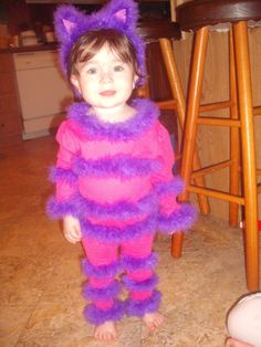 Just had to share my little cutie! DIY Children Cheshire Cat Costume: pant & shirt set, 4 yds marabou, headband, cardboard (for the ears), pink paper (inner ears), pipe cleaner (tail) and lots of hot glue! Oh, and HAIRSPRAY... spray on marabou to keep from shedding!