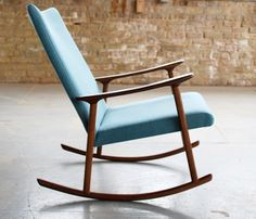 Rocking chair with solid wood frame and upholstered seat. Shown in black walnut. $1850 + customer's material, by Jason Lewis   Love it!
